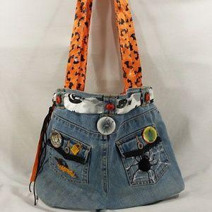 Belted denim Halloween shoulder bag embellished